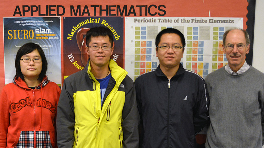 Master of Applied Mathematics students Junyu He, Yun Zhou, and Zheyuan Sun with Program Director Charles Tier